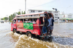 Bangkok-Nov 08 : local bus on water flooded road Royalty Free Stock Images