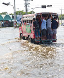 Bangkok-Nov 08 : local bus on water flooded road Royalty Free Stock Photography
