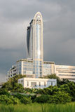 BANGKOK - OCTOBER 2014. Centara Grand and Bangkok. BANGKOK - OCTOBER 2014. Bangkok Convention Center at daytime. This new hotel tower is integrated into the royalty free stock images
