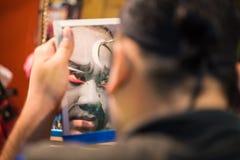 BANGKOK - OCTOBER 16: A Chinese opera acter painting mask Stock Image