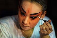 BANGKOK - OCTOBER 16: A Chinese opera actress painting mask on h Royalty Free Stock Image