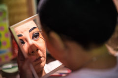 BANGKOK - OCTOBER 16: A Chinese opera actress painting mask on h Royalty Free Stock Images