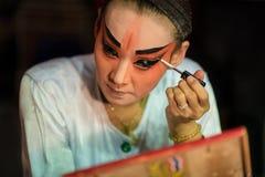 BANGKOK - OCTOBER 16: A Chinese opera actress painting mask on h Stock Photos