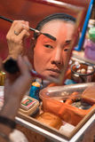 BANGKOK - OCTOBER 16: A Chinese opera actress painting mask on h Stock Photo