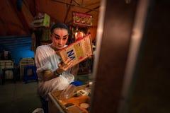 BANGKOK - OCTOBER 16: A Chinese opera actress painting mask on h Stock Photography