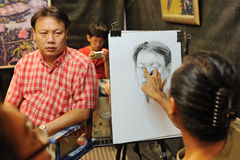 BANGKOK - OCTOBER 27: An unidentified man poses to the artist fo Stock Photos