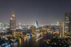 Bangkok cityscape at night. Bangkok at prime time with ship , building , and river Stock Images