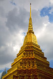 Bangkok  rain     sky    and  colors religion. Bangkok in   temple  thailand abstract cross colors roof  wat     asia sky   and  colors religion mosaic rain Royalty Free Stock Photo