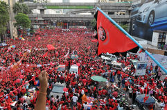 Bangkok Red-Shirt Rally. An estimated 10,000 anti-government red-shirts defy an emergency decree to protest at Ratchaprasong Junction on December 19, 2010 in Royalty Free Stock Photos