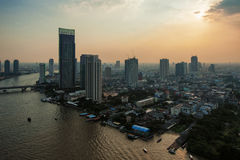 Bangkok and river. View of Bangkok and Chao Phraya river with buildings hit by the sunlight in the late afternoon Royalty Free Stock Image