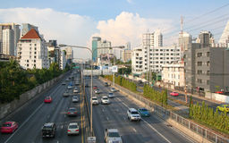 Bangkok road from the bridge. Traffic and skyscrapers in Bangkok, Thailand Stock Photos