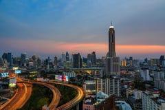 Bangkok rooftop at dusk. BANGKOK, THAILAND - 16 APRIL 2016 - Scene of Bangkok high-rise buildings and traffic light trails on expressway at dusk Stock Photo