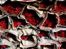 Bangkok Roses. Pak Khlong Talat Flower Market in Bangkok, Thailand.  Roses wrapped in newspaper Royalty Free Stock Images
