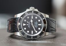 Rolex submariner no date on leather table Royalty Free Stock Photos