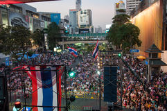 Bangkok shutdown on Feb 9, 2014. BANGKOK THAILAND - FEBRUARY 9 : Unidentified protesters gather at Ratchaprasong intersection to anti government under the royalty free stock image