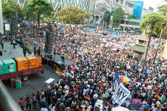 Bangkok shutdown 2014. BANGKOK THAILAND - FEBRUARY 2 : Unidentified protesters gather Ratchaprasong intersection to anti government and not voting in the day of royalty free stock image