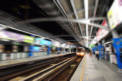 Bangkok Sky Train station with people at night in Zoom motion Blur effect Royalty Free Stock Image