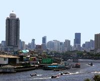 Bangkok, skyline and Chao Praya river. Bangkok: View from the famous temple wat Arun down to Bangkoks Chao Praya river, with a lot of traffic. In the background Stock Image