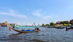 Bangkok skyline, view from Chao Phraya River. Bangkok skyline and long tail boat in first plane, view from Chao Phraya River stock photo