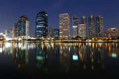 Bangkok skyline by night reflections in the water Royalty Free Stock Photography