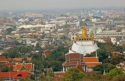 Bangkok Skyline and Temple Aerial view. Bangkok skyline and Temple Wat Phra Kaew  Emerald Buddha  Sri Rattana in foreground with Royal palace Royalty Free Stock Photo
