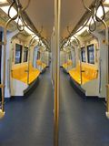 Bangkok skytrain has yellow symmetrical seats royalty free stock photo