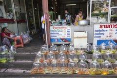 Bangkok street golden fish seller Stock Images
