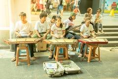 Bangkok street musicians Stock Photo
