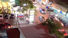 Bangkok street vendor and traffic at night from top view. Bangkok street vendor traffic at night from top view stock footage