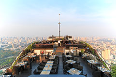 Bangkok at sunset viewed from a roof top bar Royalty Free Stock Image
