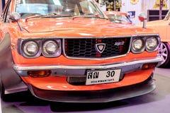 BANGKOK, TAILANDIA, - 11 DE MARZO DE 2018: Un coche Mazda RX-3 del vintage: 1971-1977 fue mostrado en un salón del automóvil clás Imagenes de archivo
