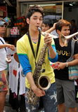 Bangkok, Tailandia: Musicista sulla strada di Khao San Fotografie Stock Libere da Diritti