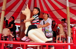 Bangkok, TH: Little Girl on Carousel Royalty Free Stock Images