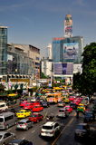 Bangkok, TH: Traffic on Ratchaprasong Road. Traffic-clogged Thanon Ratchaprasong with its glass towers, electronic signs, and modern hotels including the Bayoke Royalty Free Stock Photos