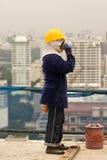 Bangkok thailändsk arbetare i en byggnadsplats Arkivbilder