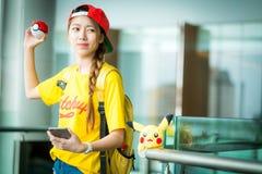 BANGKOK, THAILAND – August 14,2016:  Trainer girl playing poke Stock Photography