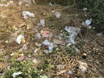 BANGKOK, THAILAND – DECEMBER 7, 2018: illegal trash and rubbish on grass field stock image