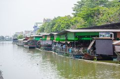 Floating restaurant alongside `Sansab` canal in suburb of Minburi. BANGKOK, THAILAND. – On March 25, 2018 - Floating restaurant alongside `Sansab` canal in stock photography