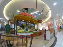 Krispy Kreme Doughnuts shop in a shopping mall. royalty free stock images