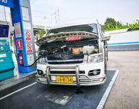 NGV gas fuel station fills with a van. stock image