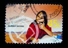 A stamp printed in Australia shows an image of Australian aboriginal kid for outback service stamp series on value at 45 cent. Stock Photography