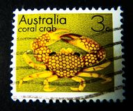 A stamp printed in Australia shows an image of yellow coral crab on value at 3 cent. stock image