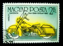 A stamp printed in Hungary shows an image of Harley Davidson duo glide 1960 on value at 2 Ft. BANGKOK, THAILAND. – On May 24, 2018 - A stamp printed in Stock Photo