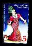 A stamp printed in Thailand shows an image of woman in Thai musical folk drama costume on on value at 5 baht. BANGKOK, THAILAND. – On May 26, 2018 - A stock photo