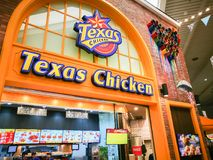 Texas Chicken or Church`s Chicken restaurant featuring Original and Spicy Fried Chicken, image shows its branding logo. BANGKOK, THAILAND. – On May 23 royalty free stock photo