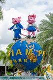 Two cute pink cat sculpture standing on a giant globe as iconic logo of Siam park city. BANGKOK, THAILAND. – On May 01, 2018 - Two cute pink cat sculpture stock image