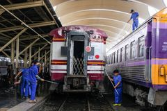 Bangkok, Thailand – November 30, 2018: Employees cleaning the train at train station. royalty free stock images