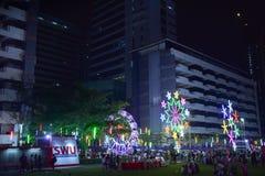 BANGKOK, THAILAND – NOVEMBER 22, 2018: night festival in the college with big light turbine and ferris wheel stock photo
