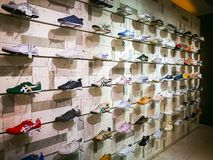 Onitsuka Tiger is one of the oldest shoe companies in Japan, image showing a male shoes collection on the shelf in shopping center. BANGKOK, THAILAND. – stock photography