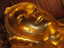 Bangkok, Thailand. Close up shot on sculptures of Sleeping Buddha head Stock Photography